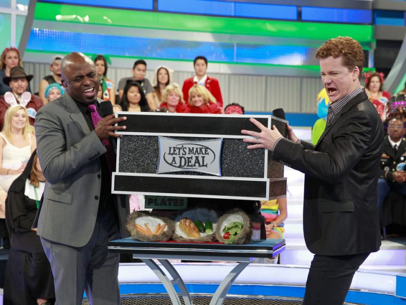 SHOW #7094 -- Host Wayne Brady, Announcer Jonathan Mangum and Model Tiffany Coyne attempt to make a deal with traders for either trips, prizes, cars, cash or the dreaded Zonks on the Daytime Emmy Award winning game show, LET'S MAKE A DEAL. Celebrate Mardi Gras with masks, beads and even a king cake! Plus with hidden prizes galore, there's no telling how crazy fun this episode could get! You'll have to see it to believe it on Fat Tuesday. This episode will air Tuesday, Feb. 9 (check local listings) on the CBS Television Network.  Photo: Monty Brinton/CBS ©2015 CBS Broadcasting, Inc. All Rights Reserved